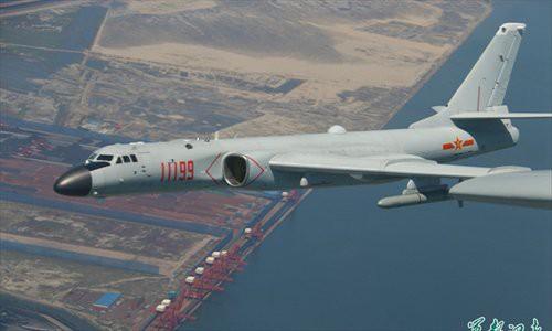 Mỹ tố Trung Quốc tập oanh kích đảo Guam - Ảnh 1.