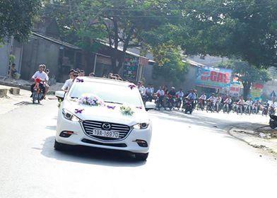 Độc đáo màn rước dâu bằng 100 xe Dream thắt nơ đỏ - Ảnh 1.