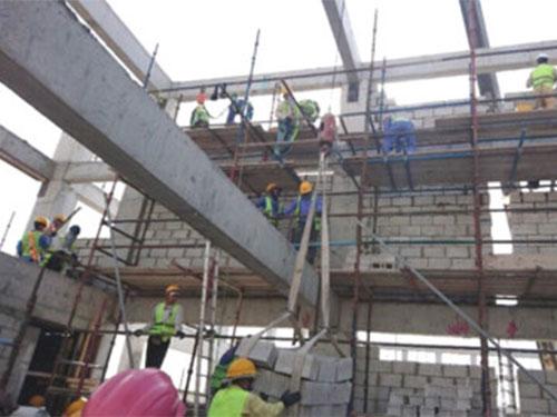 Lao động Việt Nam tại Qatar vẫn làm việc bình thường - Ảnh 1.
