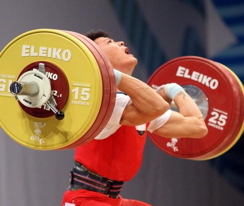 Thạch Kim Tuấn vô địch cử tạ thế giới hạng 56kg - Ảnh 1.