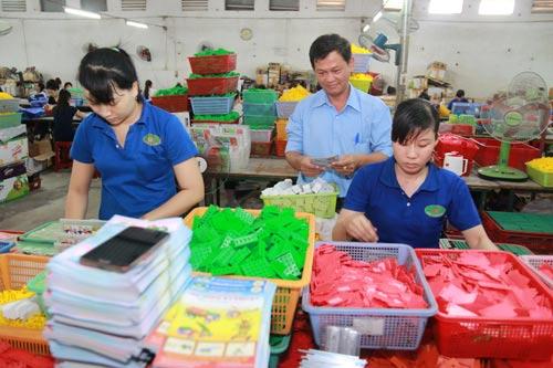 Bảo đảm quyền thụ hưởng BHXH của người lao động là trách nhiệm của doanh nghiệp Ảnh: ĐÌNH VIÊN