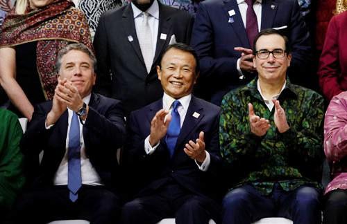 Nhiều tranh cãi phủ bóng kinh tế thế giới - Ảnh 1.