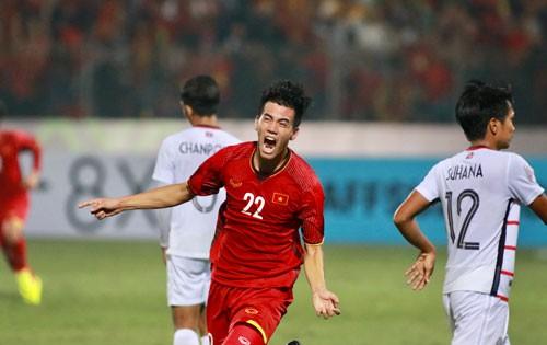 Việt Nam nhất bảng, vào bán kết - Ảnh 1.