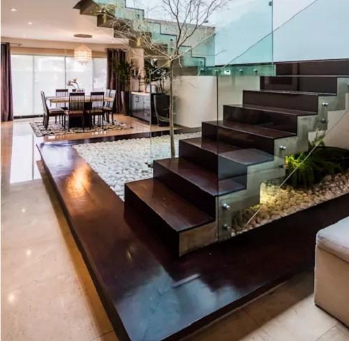 10 mẫu cầu thang gỗ đẹp hiện đại cho nhà phố chật chội - Ảnh 2.