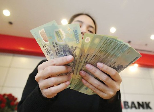 Người lao động được doanh nghiệp thưởng Tết 20.000 đồng - Ảnh 1.