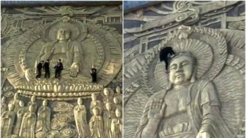 Khách Trung Quốc trèo lên bức điêu khắc Phật khổng lồ - Ảnh 1.