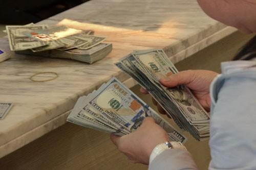 Mỹ tăng lãi suất ít ảnh hưởng đến tỉ giá USD/VNĐ - Ảnh 1.
