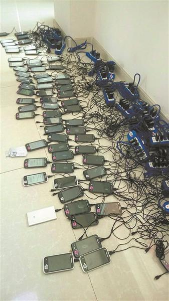 Trung Quốc phá đường dây đòi nợ thuê bằng điện thoại di động - Ảnh 1.