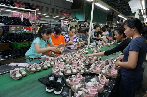 Đơn hàng dệt may, da giày sẽ tăng đột biến? - Ảnh 1.