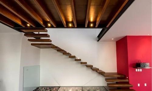 10 mẫu cầu thang gỗ đẹp hiện đại cho nhà phố chật chội - Ảnh 1.