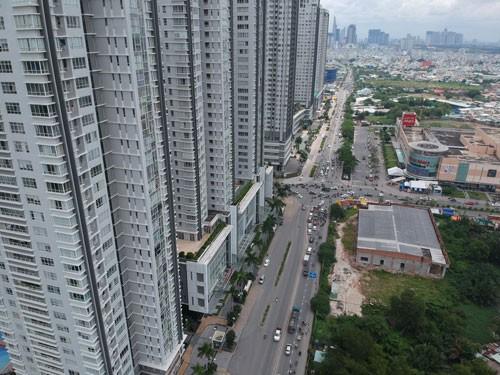 Tiếp tục siết cho vay mua nhà đất, căn hộ cao cấp từ 3 tỉ đồng trở lên - Ảnh 1.