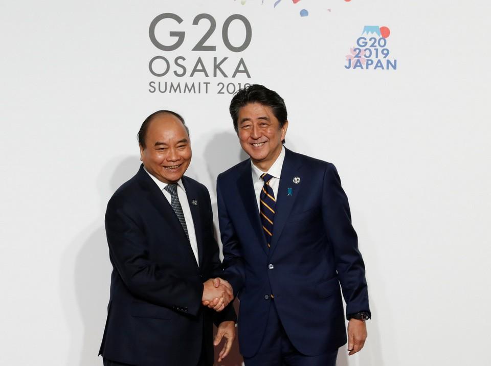[eMagazine] - Tháo gỡ vướng mắc từ các cuộc gặp song phương, bên lề Hội nghị G20 - Ảnh 4.