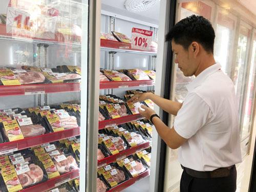 Thịt heo siêu thị cao hơn giá chợ? - Ảnh 1.