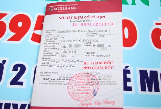 Báo Người Lao Động trao hơn 143,6 triệu đồng cho 2 cháu bé mồ côi ở Quảng Nam - Ảnh 5.