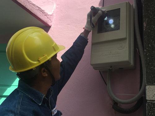 Người dân TP HCM sẽ không phải canh cửa để ghi điện - Ảnh 1.