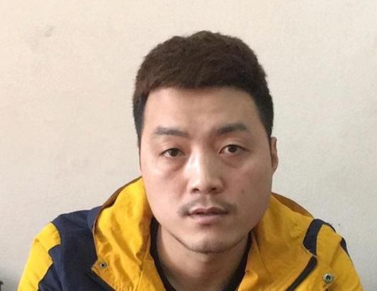 Bị truy nã trốn sang Trung Quốc, trở về quê đầu thú vì... sợ nhiễm Covid-19 - Ảnh 1.