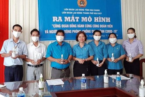 Bảo vệ sức khỏe người lao động trước dịch bệnh Covid-19 - Ảnh 1.