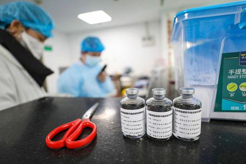 Vắc-xin ngừa Covid-19 có thể ra lò vào tháng 9 - Ảnh 1.