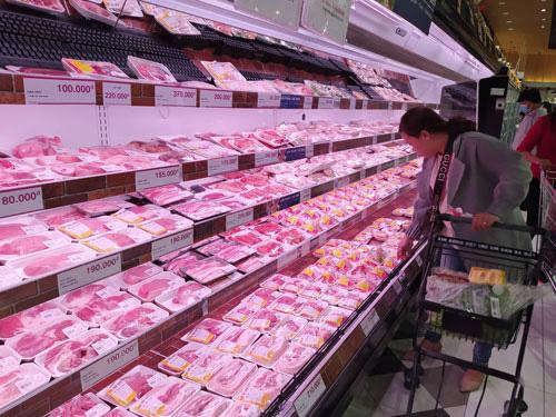 Xem xét đưa thịt heo vào hàng bình ổn giá - Ảnh 1.