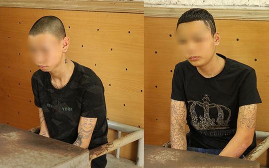 Nhóm thanh thiếu niên xăm trổ 14-18 tuổi dùng hung khí gây ra 24 vụ cướp táo tợn - Ảnh 1.