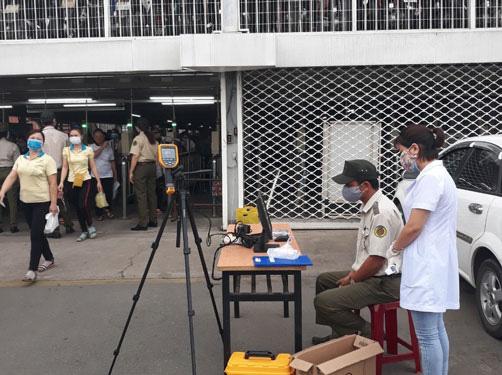 Bảo vệ công nhân an toàn trước dịch Covid-19 - Ảnh 1.