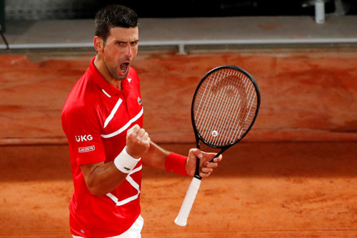 Djokovic tìm danh hiệu trên sân đất nện - Ảnh 1.