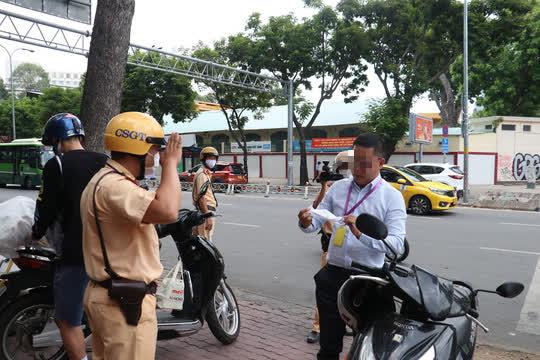 CSGT TP HCM sẽ xử phạt người đi đường không mang khẩu trang - Ảnh 7.