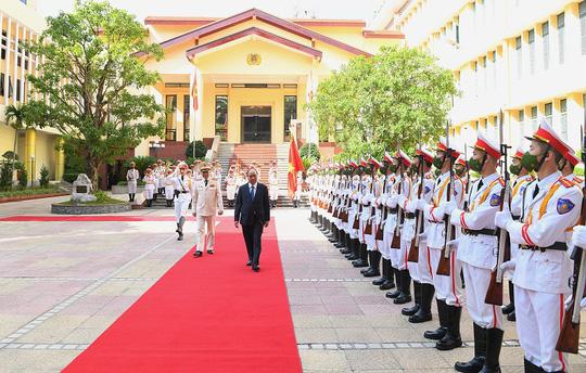 Chủ tịch nước dự Lễ kỷ niệm 75 năm Ngày truyền thống lực lượng An ninh nhân dân - Ảnh 1.
