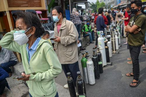 Indonesia và Thái Lan ngóng chờ vắc-xin Covid-19 - Ảnh 1.