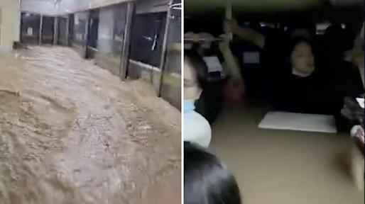 Trung Quốc: Đường phố thành sông, nước ngập tới ngực hành khách đi tàu hỏa - Ảnh 1.