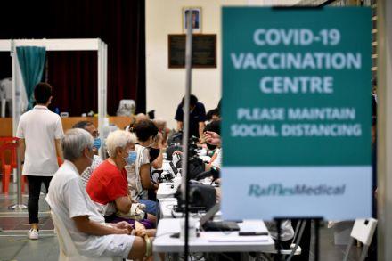"""Từ """"miễn đăng ký"""" đến """"gõ cửa từng nhà"""" để phủ sóng vắc-xin Covid-19 - Ảnh 5."""