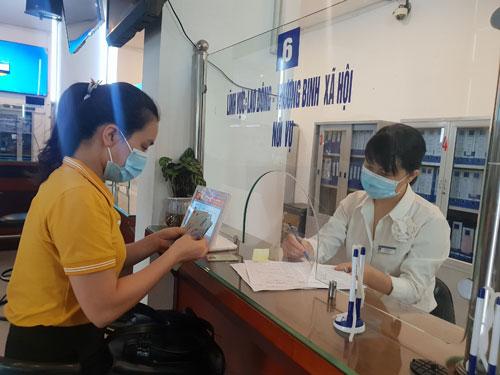 Hà Nội: Lao động tự do được tiếp cận gói hỗ trợ an sinh - Ảnh 1.
