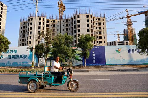 Bom nợ Evergrande đe dọa kinh tế Trung Quốc - Ảnh 1.
