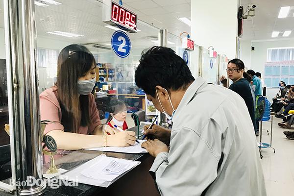 Người lao động tại đơn vị phá sản còn nợ tiền BHXH được giải quyết chế độ BHXH thế nào? - Ảnh 1.