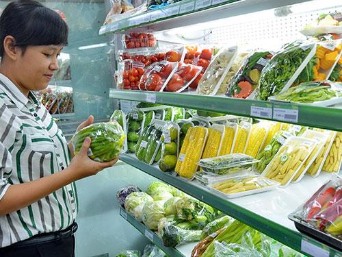 Sở Công Thương TP HCM đang xúc tiến lại chương trình đưa rau VietGAP vào chợ truyền thống Ảnh: TẤN THẠNH