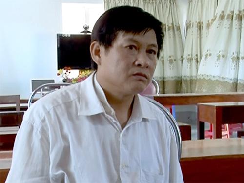 Nghi can Đàm Quang Trung bị bắt quả tang khi đang vận chuyển 8 bánh heroin cùng đồng phạm - Ảnh: VNE