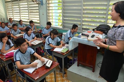 Học sinh Trường THCS Nguyễn Văn Tố (TP HCM) trong giờ học Ảnh: TẤN THẠNH