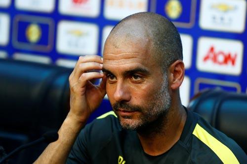 HLV Guardiola khá bình thản trước trận đấu gặp Jose Mourinho Ảnh: REUTERS