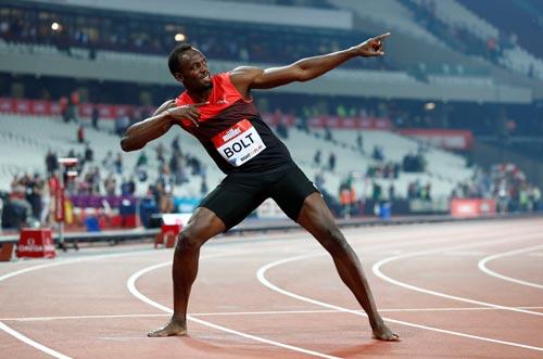 Bolt và kiểu ăn mừng quen thuộc sau chiến thắng ở London cách đây hơn 1 tuần Ảnh: REUTERS