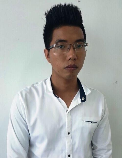 Trần Đình Tùng tại cơ quan công an