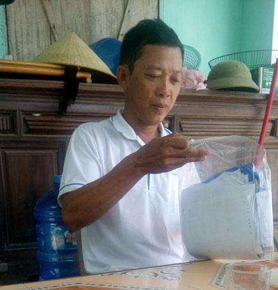 Một phần cánh đồng Sào Sạn (thôn Nam Lãnh, xã Quảng Phú, huyện Quảng Trạch, tỉnh Quảng Bình - ảnh trên) đã quy hoạch xây dựng khu tái định cư và ông Lê Nhớ Thương - trưởng thôn Nam Lãnh (ảnh dưới)