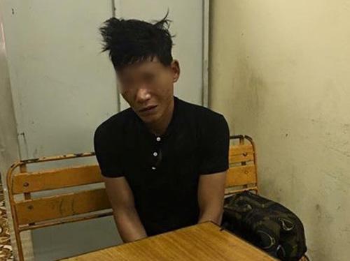 1 trong 2 nghi phạm bị bắt giữ tại cơ quan công an