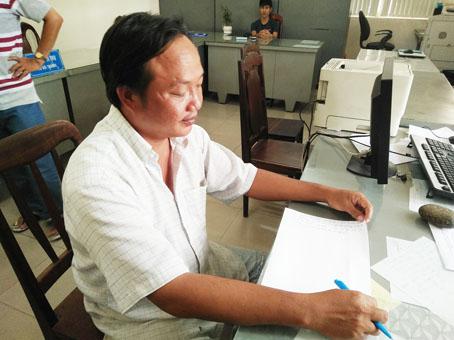Trương Chí Hiếu tại cơ quan công an.