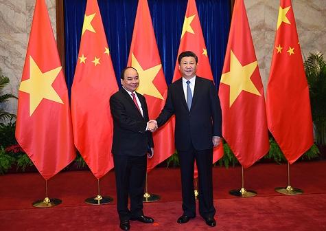 Thủ tướng Nguyễn Xuân Phúc hội kiến với Tổng Bí thư, Chủ tịch Tập Cận Bình Ảnh: VGP