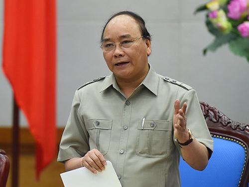 Thủ tướng Nguyễn Xuân Phúc chỉ đạo tập trung lực lượng, tìm bằng được phi công máy bay Su-30 MK2 mất tích là Thượng tá Trần Quang Khải - Ảnh: VGP
