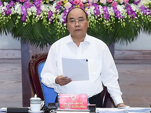 Thủ tướng Nguyễn Xuân Phúc yêu cầu hoàn thành kế hoạch sử dụng số tiền 500 triệu đền bù của Formosa trong tháng 7-2016 - Ảnh: VGP