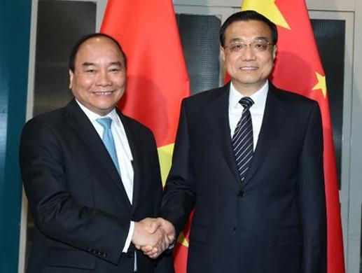 Thủ tướng Nguyễn Xuân Phúc và Thủ tướng Trung Quốc Lý Khắc Cường ngày 14-7-2016 - Ảnh: TTXVN