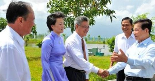 Ông Nguyễn Thanh Mỹ (giữa) trong một lần chào mừng nguyên Chủ tịch nước Nguyễn Minh Triết.