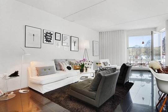 Không gian hiên đại của phòng khách được mang đến bởi sự tương phản giữa đen - xám - trắng.