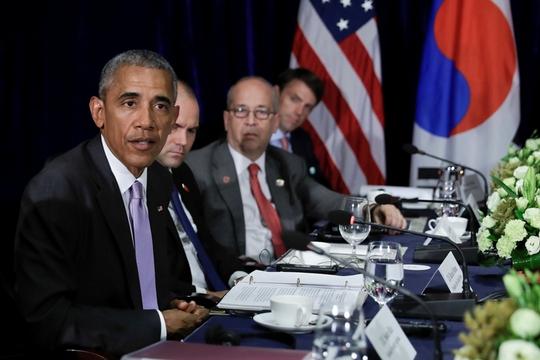 Tổng thống Obama nói tại cuộc họp báo ở Vientiane - Lào hôm 6-9 sau cuộc gặp với Tổng thống Hàn Quốc Park Geun-hye. Ảnh: AP